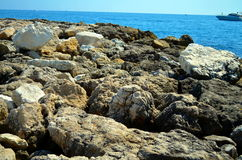 Rocky coast at french riviera with blue water Royalty Free Stock Photos