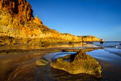 Rocky coast in golden sunlight Stock Photography