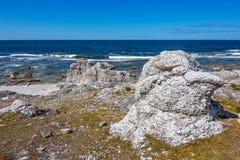 Rocky coast of Gotland, Sweden. Rocky coast of Fårö island in Gotland, Sweden. Rock formation reminding a head of a bird Stock Photos