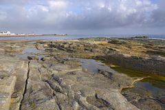 Rocky coast of Guilvinec in France stock photos