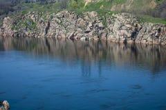 Rocky coast of Hortica Island stock photography