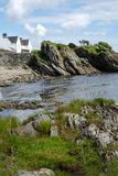Rocky Coast. Houses by the rocky coastline, Islay - Scotland Stock Photo