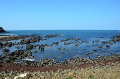 Rocky coast of Ireland with blue sea in summer Royalty Free Stock Photography