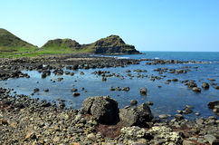 Rocky coast of Ireland with rocks and blue sea in summer Royalty Free Stock Photography