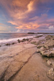 Rocky coast on the island of Curaçao at sunset Stock Photography