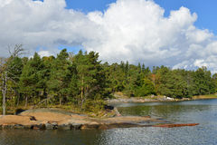 Rocky coast of island. Helsinki shoreline is adorned by around 100 km of coast and over 300 islands of which many are accessible for recreational use Stock Photography