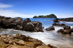 Rocky coast and islet of Vila Franca, Sao Miguel, Azores Royalty Free Stock Image