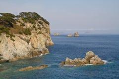 The rocky coast of the Japanese sea. Japan Sea coast with small rocks on the horizon Royalty Free Stock Images