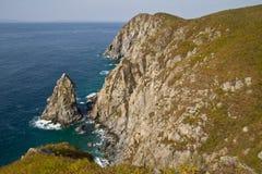 The rocky coast of the Japanese sea. Japan Sea coast with small rocks on the beach Stock Image