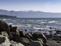 Rocky coast of Lake Tahoe. With wind whipping up the waves stock images
