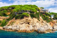 Free Rocky Coast Landscape In Mediterranean With Modern Beautiful House On High Sea Shore In Costa Brava, Spain Stock Image - 144200141