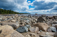 Rocky Coast. Large rocks and boulders on the shore of a bay royalty free stock images