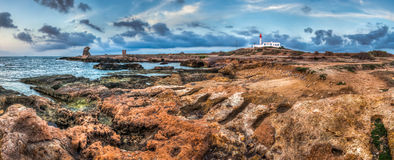 Rocky coast with lighthouse Royalty Free Stock Image