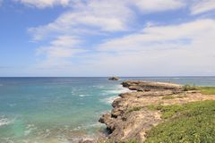 Rocky coast line of Leie Point, a popular tourist attraction on the North Shore of Oahu, Hawaii. Scenic views of the rocky coast line of Leie Point, a popular royalty free stock photo