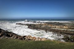 Rocky coast line in Storms River in Tsitsikamma National Park, South Africa Stock Image