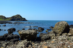 Rocky coast with many rocks in Ireland with blue sky Stock Photography