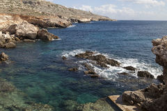 Rocky coast of Mediterranean Sea with blue water on Malta, Europe Royalty Free Stock Image