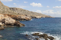 Rocky coast of  Mediterranean Sea with blue water on Malta. Europe Stock Image