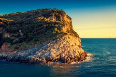 Rocky coast and Mediterranean sea at sunset Stock Image