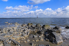 Rocky Coast Morris Island Lighthouse-Sc van het Dwaasheidsstrand stock fotografie