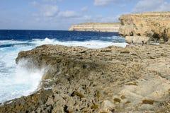 The rocky coast near missing Azure Window in Gozo Island, Malta. Gozo island, Malta - 30 October 2017: people walking on the rocky coast near missing Azure Stock Images