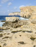 The rocky coast near missing Azure Window in Gozo Island, Malta.. Wave splashing on the rocky coast near missing Azure Window in Gozo Island, Malta Stock Images