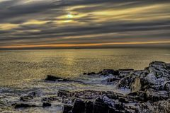 Maine rocky coast at dawn. Rocky coast near Portland Maine at sunrise Stock Image