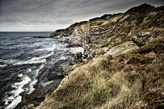 Rocky coast near Saint Jean de Luz, France. Rocky coast and Atlantic Ocean near Saint Jean de Luz, France Stock Photo