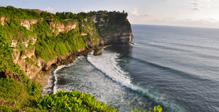 Rocky coast near Uluwatu temple on Bali Stock Images