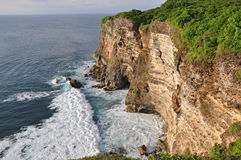 Rocky coast near Uluwatu temple on Bali Royalty Free Stock Photography