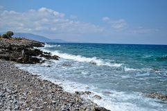 Rocky coast and the never ending sea in Crete, Greece. Beautiful turquoise sea with rocky coast in Crete with sunny weather and nice blue sky Stock Image