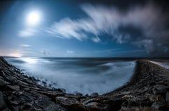 Rocky coast at night Royalty Free Stock Photos