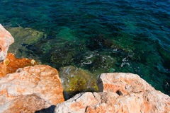 Rocky Coast in the Ocean Royalty Free Stock Images