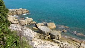 Rocky coast of the ocean and green tropic tree on the left, Koh Samui. Thailand stock video footage