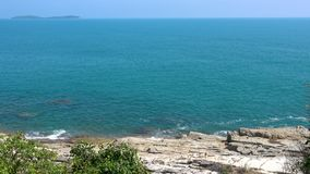 Rocky coast of the ocean and green tropic tree on the left, Koh Samui. Rocky coast of the ocean and green tropic tree on the left, Koh Samui, Thailand stock video footage