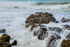 Rocky Coast Ocean Surf Waves. Force of Nature displayed in seascape with pounding surf against rock coast royalty free stock photos