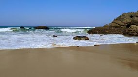 The rocky coast of Portugal, waves of Atlantic Ocean, sandy beach stock video footage