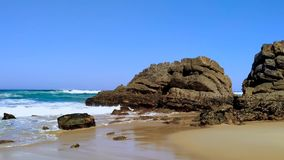 The rocky coast of Portugal, waves of Atlantic Ocean, sandy beach. The rocky coast of Portugal, waves of Atlantic Ocean, sandy Adraga beach stock video footage