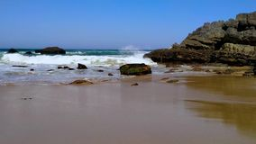 The rocky coast of Portugal, waves of Atlantic Ocean, sandy beach stock footage