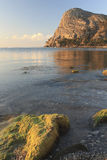 Rocky coast in the rays of the rising sun. In Crimea, September 11, 2012 royalty free stock photo