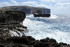 Rocky coast with a rough sea. In Gozo, Malta Stock Photography