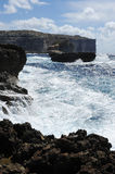 Rocky coast with a rough sea. In Gozo, Malta Stock Images