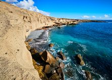 Rocky coast of San Miguel del Tajao of the southeast part of Tenerife at sunrise in the Spanish Canary Islands.  stock images