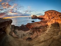 Rocky coast of San Miguel del Tajao of the southeast part of Tenerife at sunrise in the Spanish Canary Islands.  stock photos
