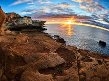 Rocky coast of San Miguel del Tajao of the southeast part of Tenerife at sunrise in the Spanish Canary Islands.  royalty free stock photography