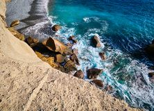 Rocky coast of San Miguel del Tajao of the southeast part of Tenerife at sunrise in the Spanish Canary Islands.  stock image