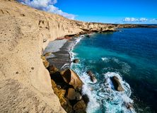 Rocky coast of San Miguel del Tajao of the southeast part of Tenerife at sunrise in the Spanish Canary Islands.  stock photo