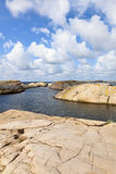 Rocky coast at sea Stock Images