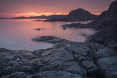 Rocky coast of the sea at dawn. Royalty Free Stock Images