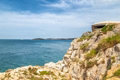 Rocky coast with shelter in Rovinj at the Adriatic Sea, Croatia, stock images